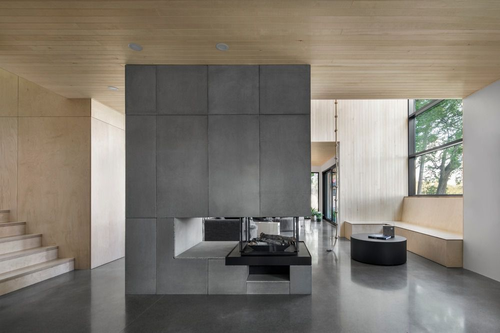 Concrete fireplace in living room