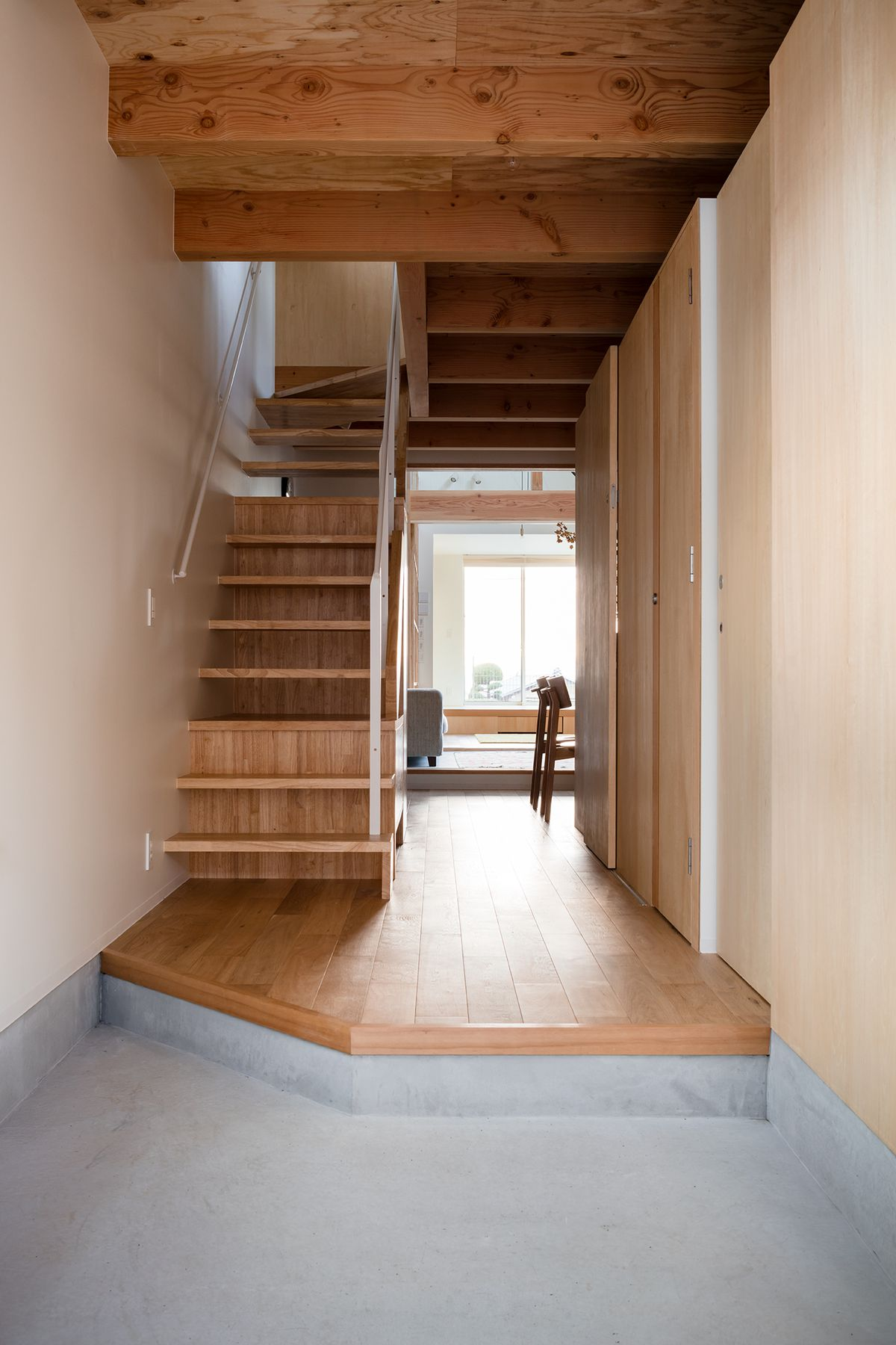 Wooden stairs leading to second story.
