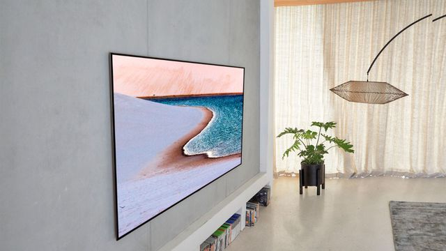 An LG GX OLED TV installed on a living room wall