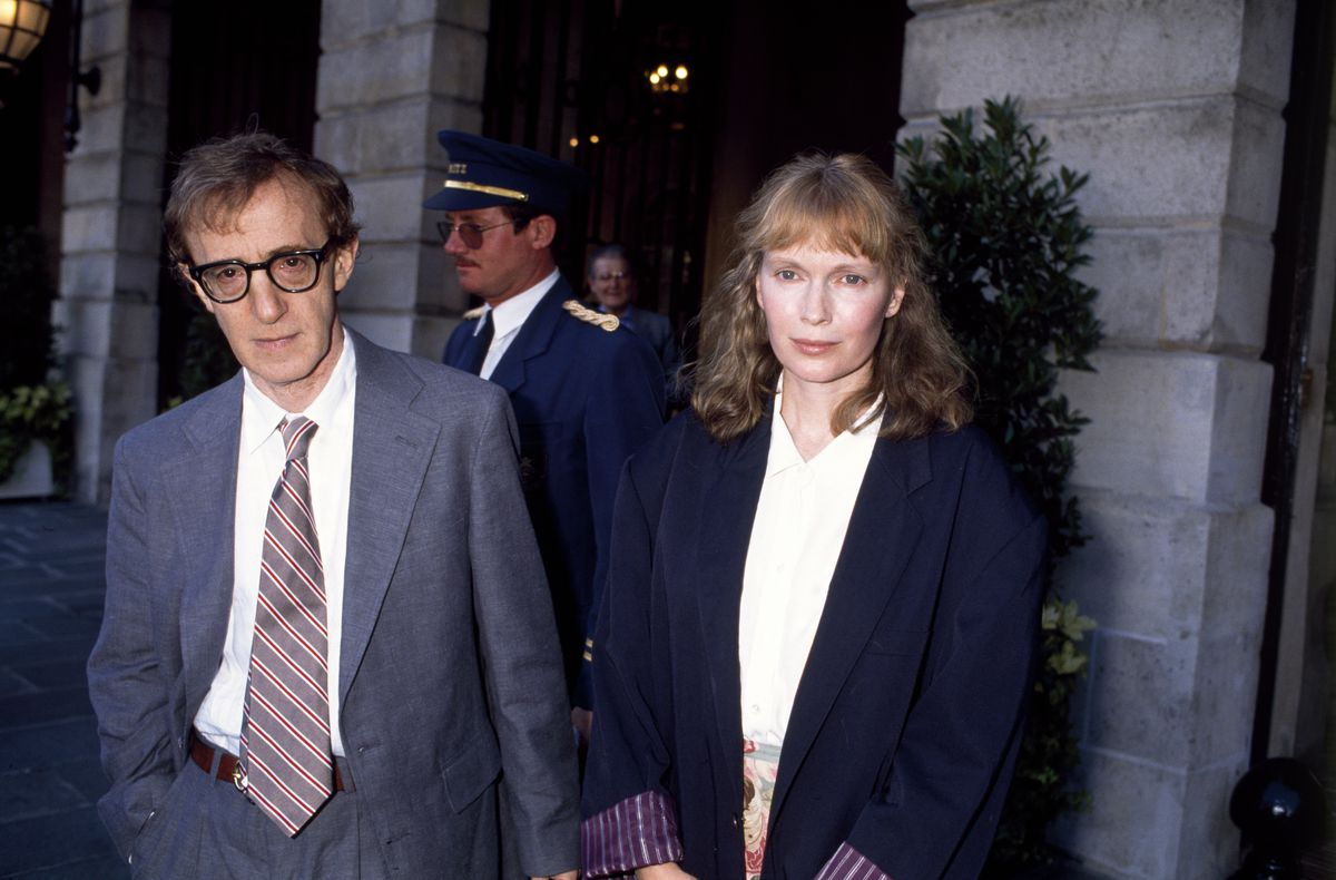 Woody Allen and Mia Farrow on a street in Paris