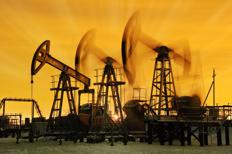 oil-derricks Big Oil is using brute financial force to kill 2 state sustainability initiatives