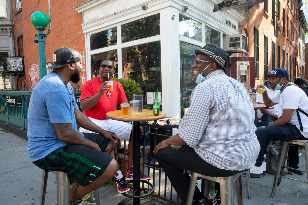 People enjoy some drinks outside Mo's Bar in Fort Greene, Brooklyn during the city's Phase 2 reopening, June 23, 2020.