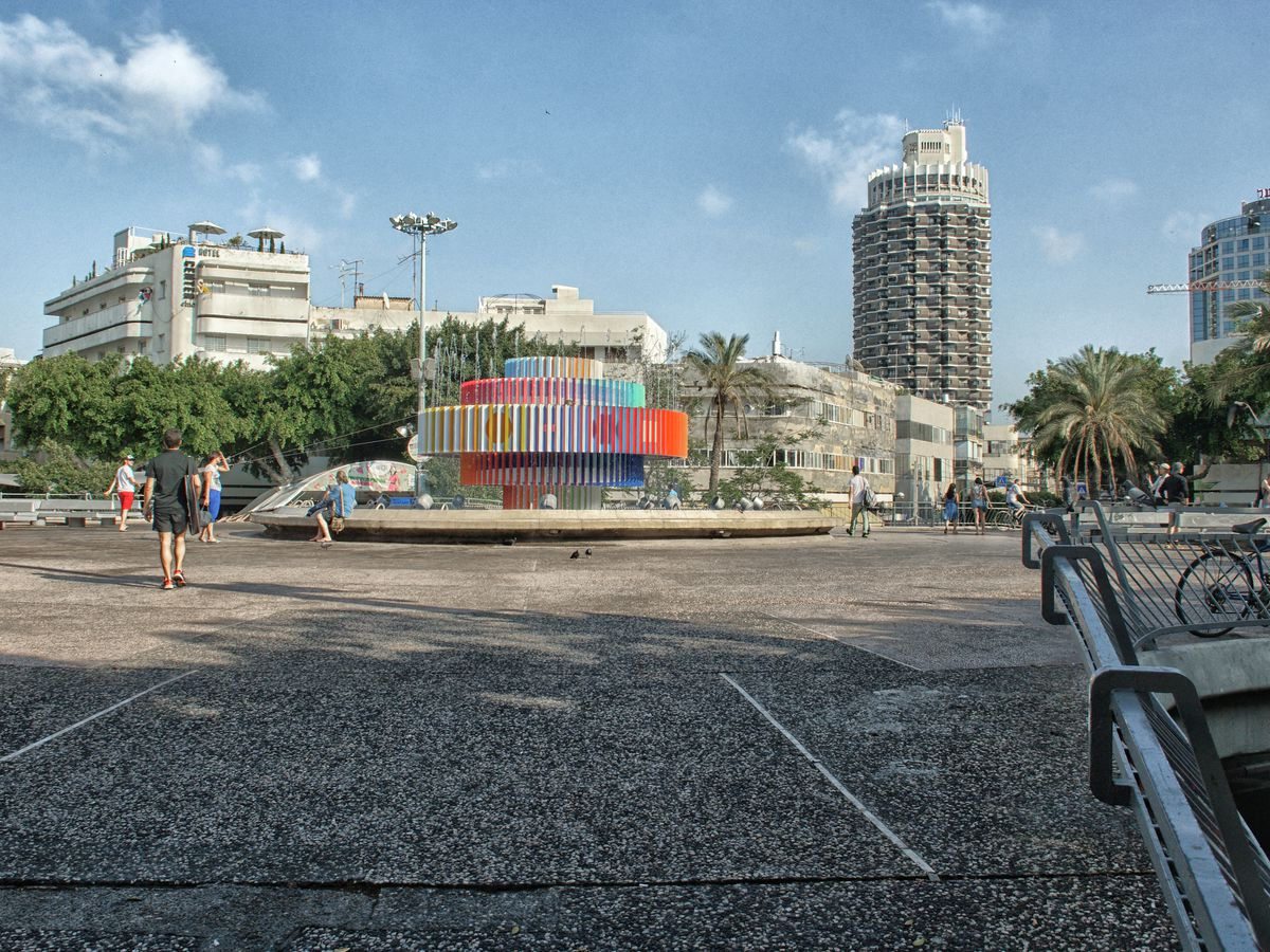 Dizengoff Square in Tel Aviv. The square is surrounded by various city buildings.