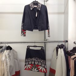 This embroidered leather jacket and skirt are $200 apiece, and obviously belong together.