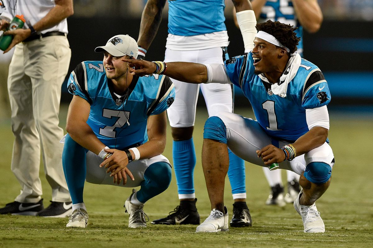 Cam Newton and teammate Kyle Allen of the Carolina Panthers react after a third quarter touchdown against the Miami Dolphins during the game at Bank of America Stadium on August 17, 2018 in Charlotte, North Carolina.