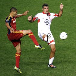 Alvaro Saborio of Real Salt Lake fights to control the ball against Emiliano Dudar of DC United during their MLS matchup at Rio Tinto Stadium in Sandy Saturday, September 1, 2012