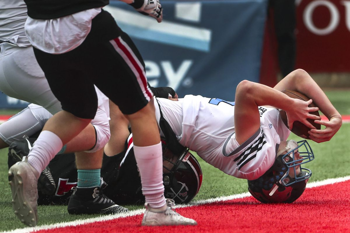 Sky View quarterback Kason Carlsen stretches for the end zone during the 4A state championship football game between Sky VIew and Park City at Rice-Eccles Stadium in Salt Lake City on Friday, Nov. 22, 2019. Carlsen came up just short of the goal line.