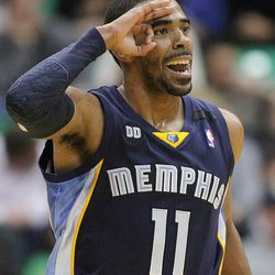 Mike Conley celebrates a three point shot as the Utah Jazz and the Memphis Grizzlies play Saturday, Dec., 15, 2012, at Energy Solutions arena. Jazz lost 99-86.