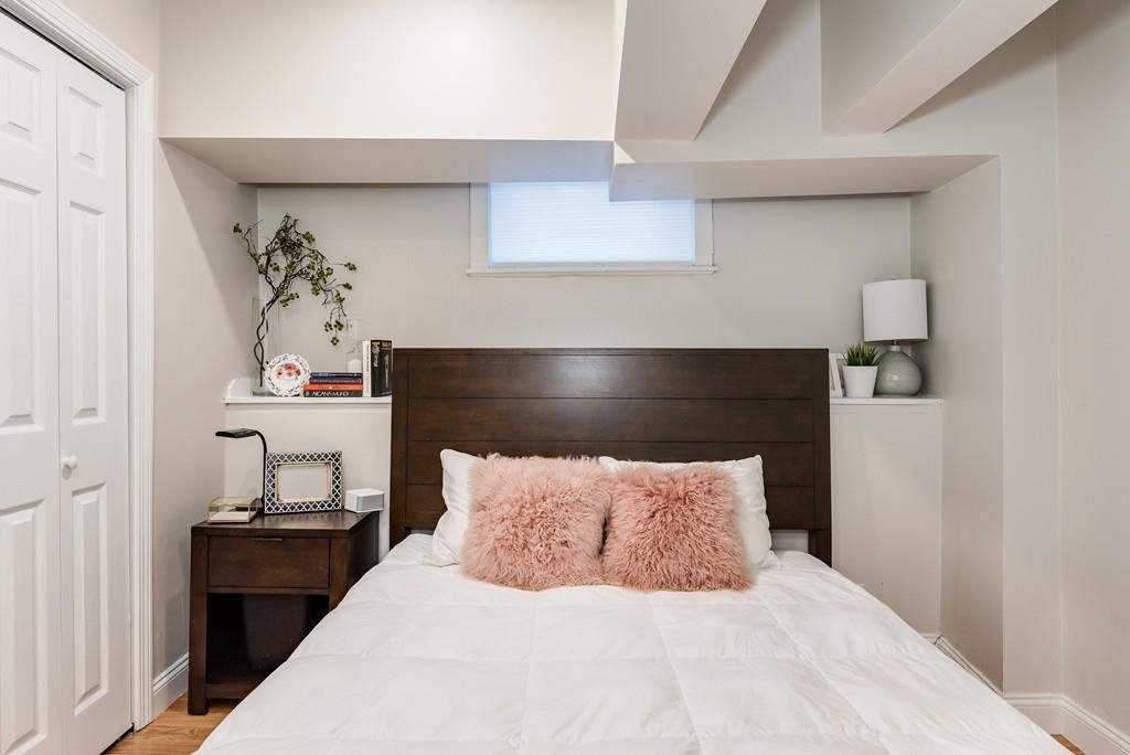 A small bedroom with a bed.
