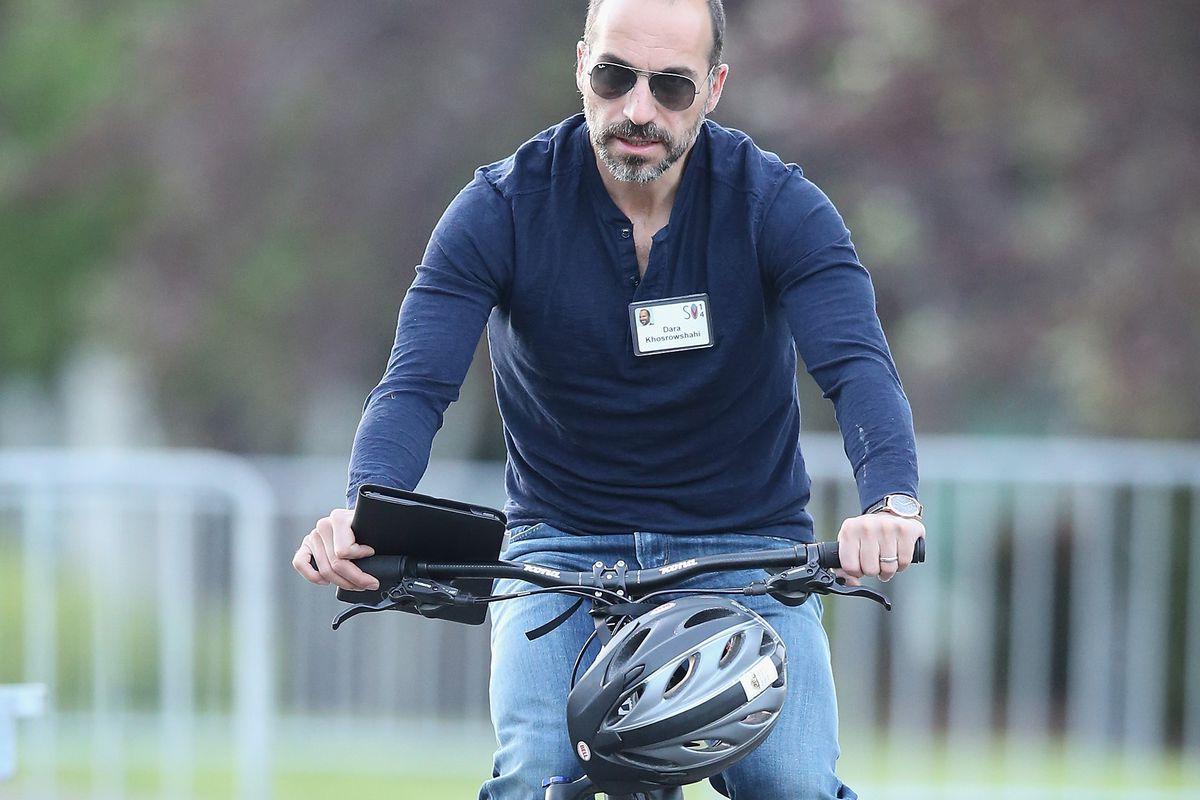Uber CEO Dara Khosrowshahi on a bicycle