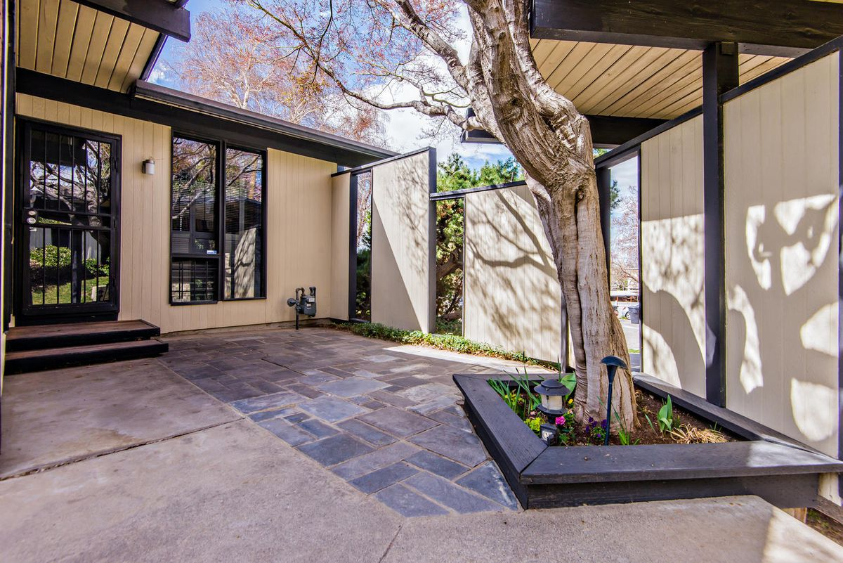Midcentury Showstopper With Floating Accordion Roof Asks