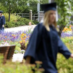 Graduates get ready for the processional before BYU's summer commencement exercises at the Marriott Center in Provo on Thursday.