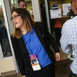Nadia Bowman, candidate for chair of the Utah Democratic Party, hustles from one caucus meeting to another at the party's organizing convention at Weber State University in Ogden on Saturday, June 17, 2017.