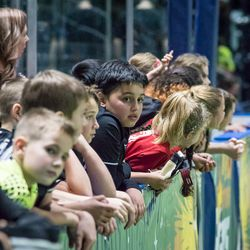During warm-ups, the youth players are often allowed into the team bench area