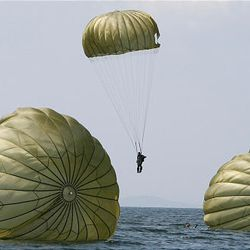 South Korean special warfare command soldiers parachute down from a helicopter during a sea infiltration drill in Taean, south of Seoul, South Korea, Wednesday.