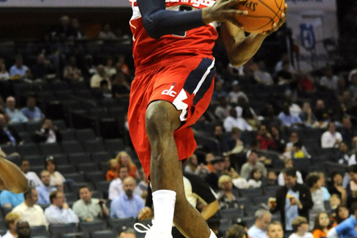 April 9, 2012; Charlotte, NC, USA; Washington Wizards guard John Wall (2) drives to the basket and scores during the game against the Charlotte Bobcats at Time Warner Cable Arena. Mandatory Credit: Sam Sharpe-US PRESSWIRE