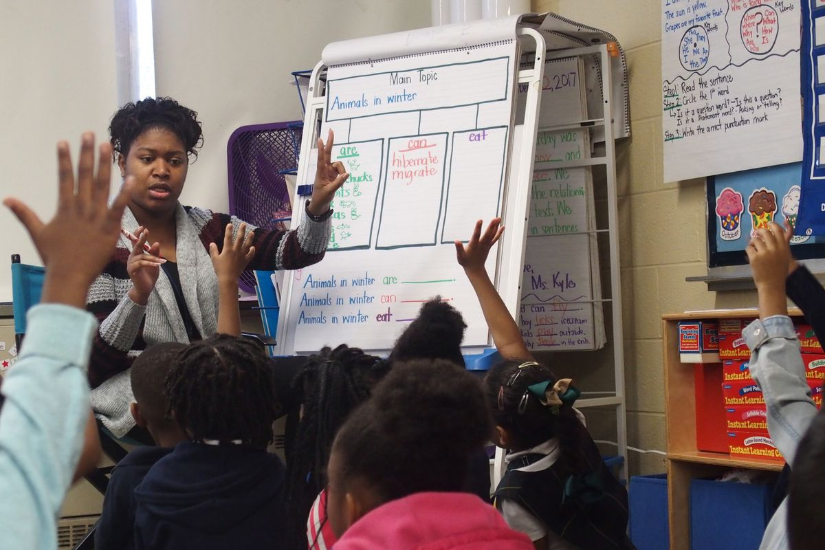 A teacher for Shelby County Schools calls on a student.