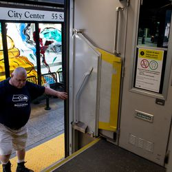 Paul Lane boards a TRAX train in downtown Salt Lake City on Thursday, May 7, 2020.
