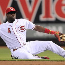 Cincinnati Reds second baseman Brandon Phillips throws to first to make the out on Los Angeles Dodgers' Mark Ellis after fielding a ground ball in the third inning of a baseball game, Friday, Sept. 21, 2012, in Cincinnati.