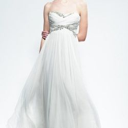"""Month 6: The sweetheart neckline of <a href=""""http://www.elizabethjohns.com/products/marchesa-b30805gemma/"""">Marchesa's """"Gemma"""" Gown</a> (price upon request at Elizabeth Johns) will accenuate your now-ample bustline."""