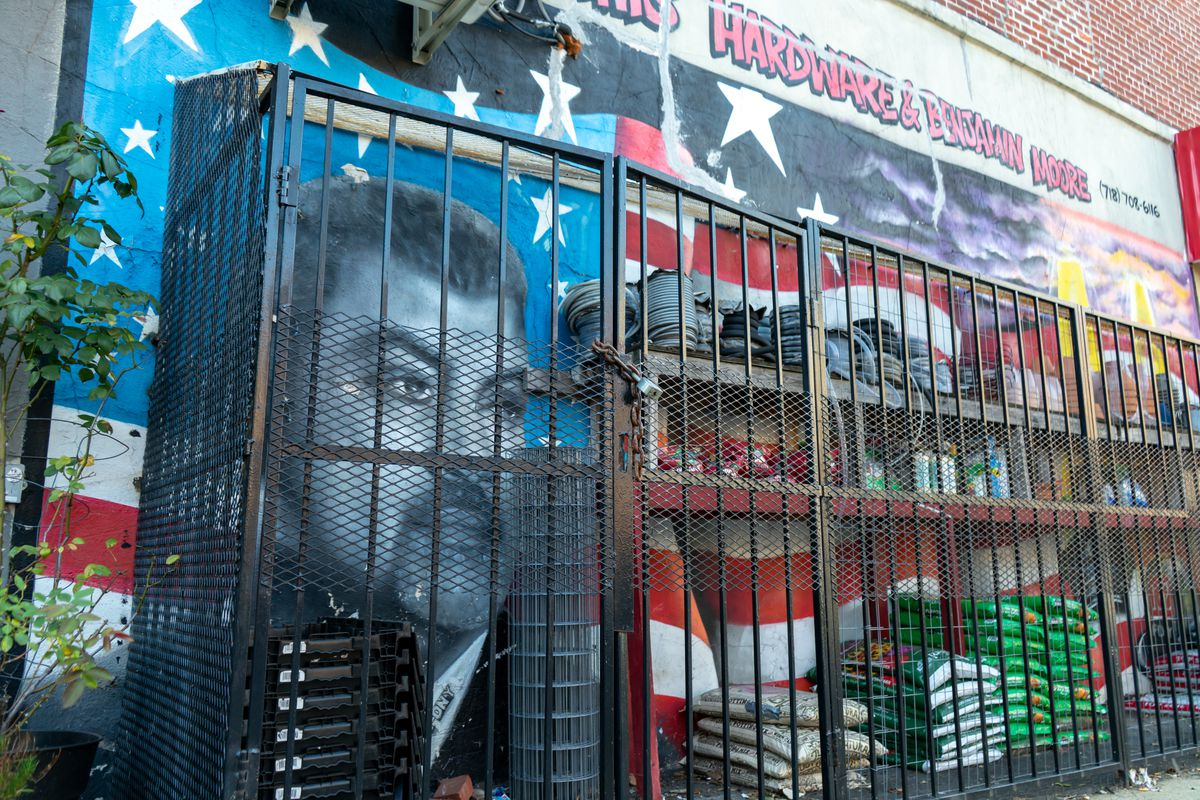 """In Crown Heights on the exterior wall of a hardware store remains a mural dedicated to 9/11 survivor, Joe Conzo, a former emergency worker and graffiti artist who survived the terrorist attack."""""""