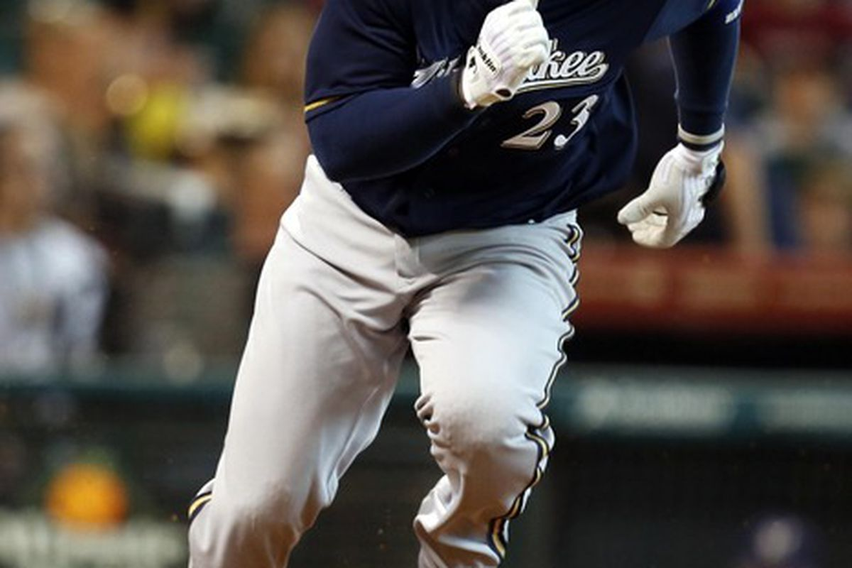 May 16, 2012; Houston, TX, USA; Milwaukee Brewers second baseman Rickie Weeks (23) runs to first base against the Houston Astros during the first inning at Minute Maid Park. Mandatory Credit: Thomas Campbell-US PRESSWIRE
