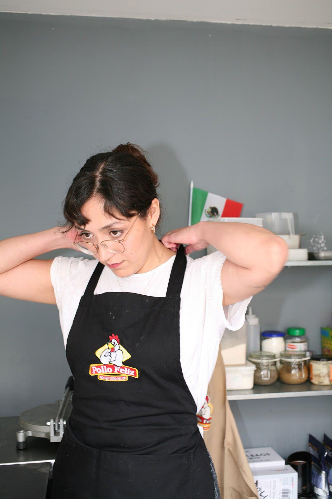 Michelle Salazar de la Rocha of Sonora Taqueria wearing a Pollo Feliz apron last year