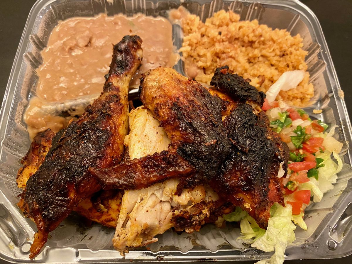 La Selva's half-chicken plate, with rice and beans, in a to-go container