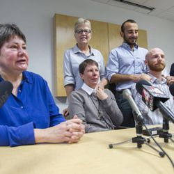 Kate Call, and other same sex couples gather Monday, Oct. 6, 2014, in the office of Peggy Tomsic in Salt Lake City, after the Supreme Court refused to hear appeals on same sex marriages, making them legal.