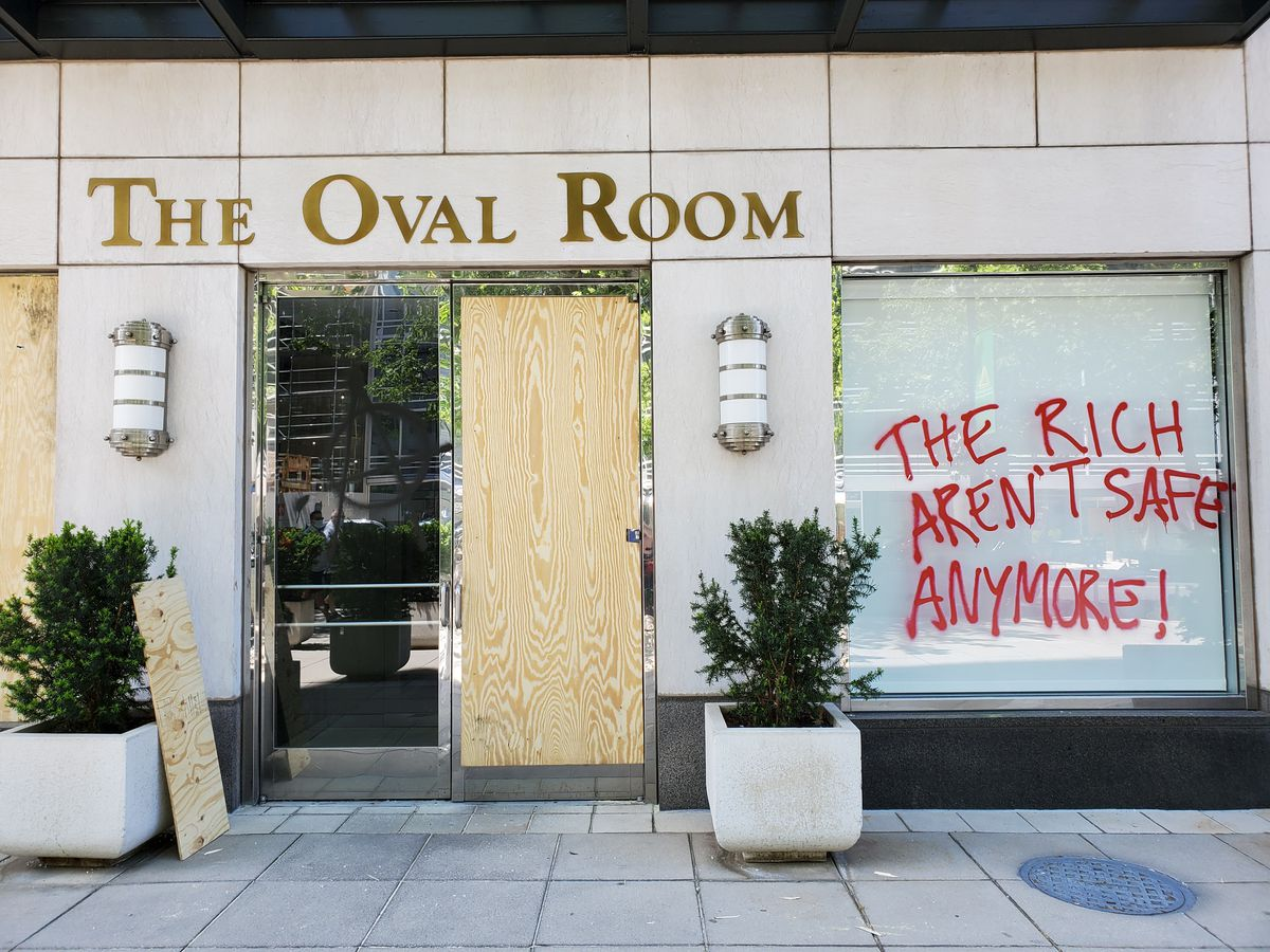 Graffiti scrawled on the front window of the Oval Room on Sunday afternoon