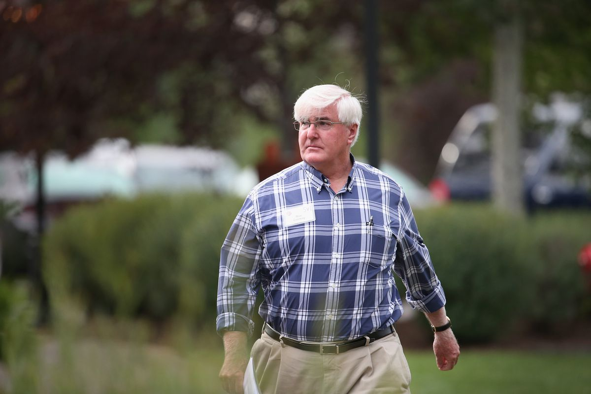 Ron Conway walks across a field