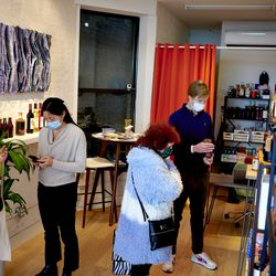 Douglas Watters, right, owner of the alcohol-free bottle shop Spirited Away, helps a customer in the Lower East Side of Manhattan in New York on Saturday, March 13, 2021. The shop is devoted to everything needed to make alcohol-free cocktails.