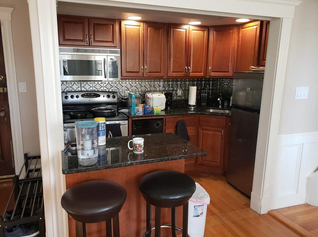 The same small kitchen area, but closer up and showing some of the counter and appliances.