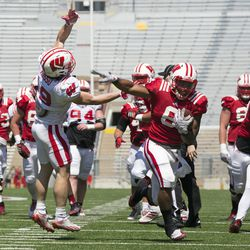 Two Badgers engage in contact during the scrimmage