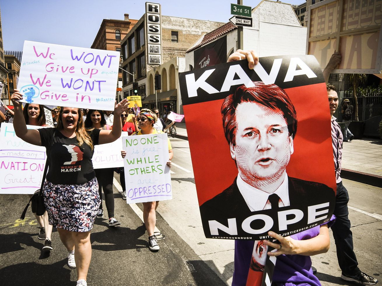"""Demonstrators march during the """"Unite For Justice"""" rally in protest of Judge Brett Kavanaugh's confirmation to the US Supreme Court in Los Angeles on August 26, 2018."""