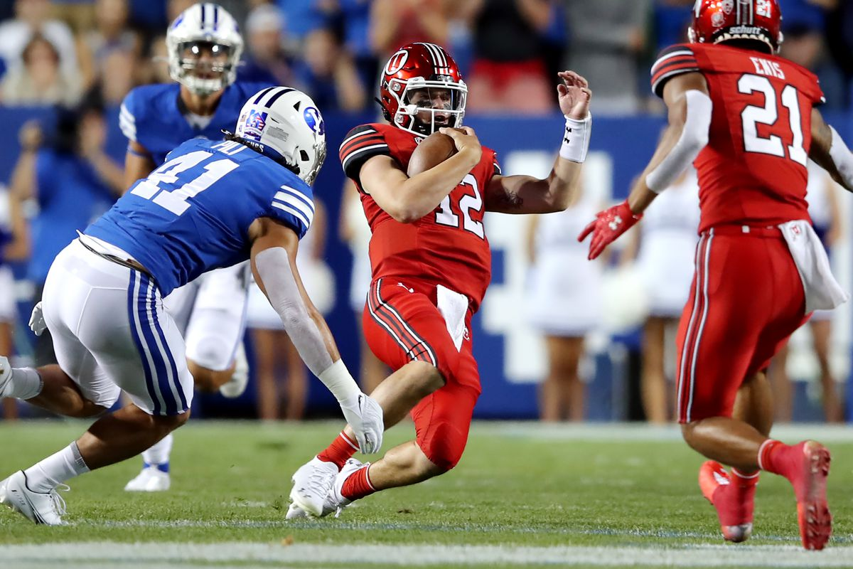 BYU Cougars linebacker Keenan Pili (41), shown closing in on Utah quarterback Charlie Brewer, is out for the season with an ACL injury.