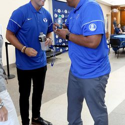 Quarterback Tanner Mangum and head coach Kalani Sitake chat at BYU Football Media Day at BYU Broadcasting in Provo on Friday, June 23, 2017.