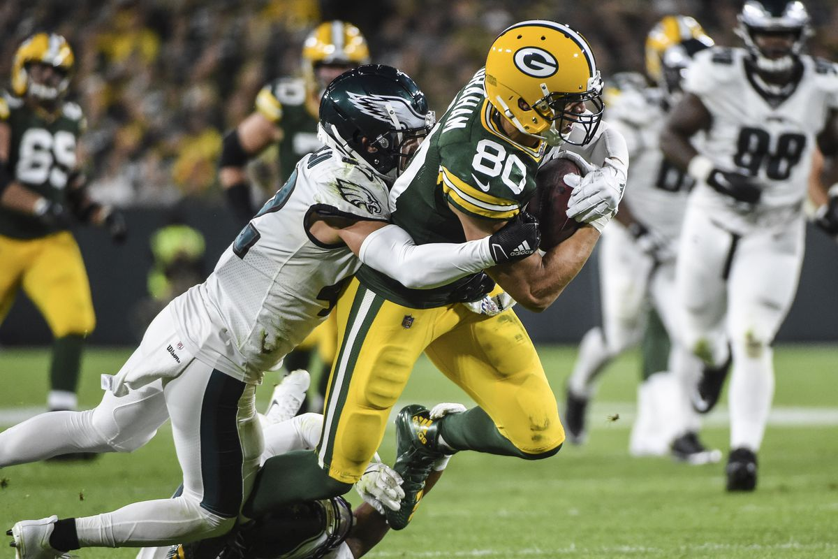 Green Bay Packers tight end Jimmy Graham is tackled by Philadelphia Eagles strong safety Andrew Sendejo in the third quarter at Lambeau Field.