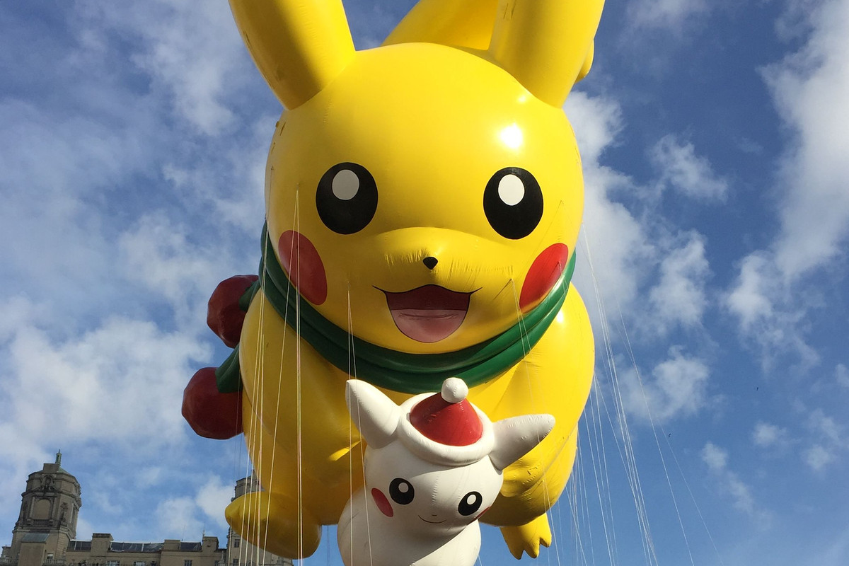 A Pikachu balloon flies over New York City in the Macy's Thanksgiving Day Parade