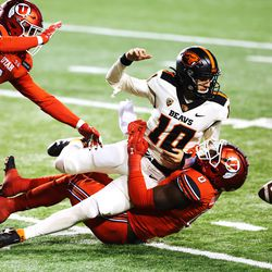 Oregon State Beavers quarterback Chance Nolan (10) loses the ball as he is sacked by Utah Utes linebacker Devin Lloyd (0) as Utah and Oregon State play a college football game at Rice Eccles stadium in Salt Lake City on Sunday, Dec. 6, 2020. Utah won 30-24.