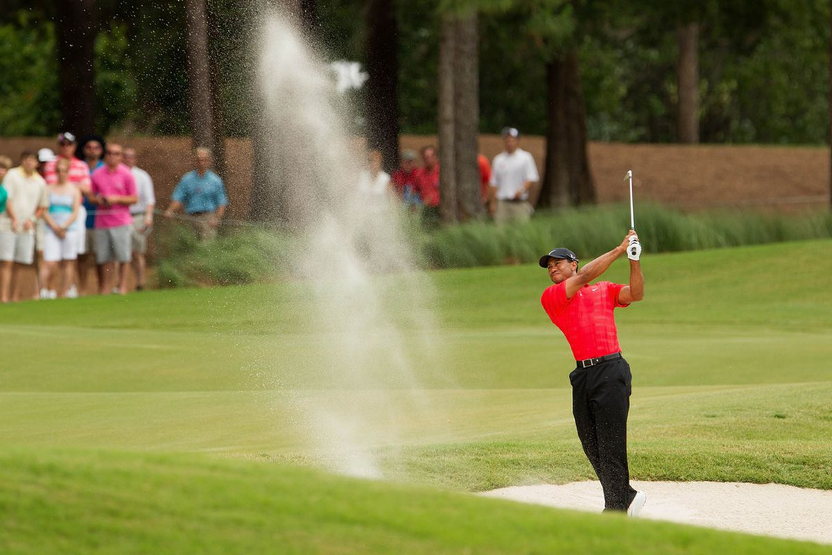 May 13, 2012; Ponte Vedra Beach, FL, USA; Tiger Woods plays from a fairway bunker on the sixth hole during the final round of the PLAYERS Championship at TPC Sawgrass.  Mandatory Credit: Allan Henry-US PRESSWIRE