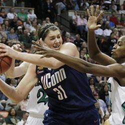 Connecticut center Stefanie Dolson (31) Notre Dame forward Devereaux Peters, right, work during the first half of the NCAA women's Final Four semifinal college basketball game, in Denver, Sunday, April 1, 2012.