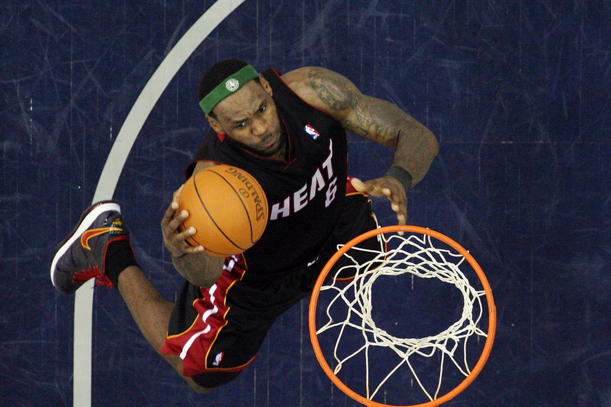NEWARK, NJ - APRIL 03:  LeBron James of the Miami Heat lays up a basket against the New Jersey Nets at the Prudential Center on April 3, 2011 in Newark, New Jersey.The Heat defeated the Nets 108-94.(Photo by Jim McIsaac/Getty Images)