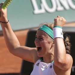 Latvia's Jelena Ostapenko celebrates her win over Timea Bacsinszky of Switzerland during their semifinal match of the French Open tennis tournament at the Roland Garros stadium, Thursday, June 8, 2017 in Paris.