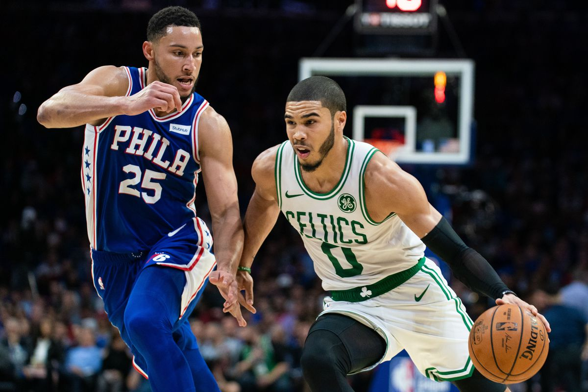 Boston Celtics forward Jayson Tatum dribbles against Philadelphia 76ers guard Ben Simmons during the third quarter at Wells Fargo Center.