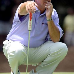 Boo Weekley looks for his shot on the green of the first hole during the third round of the RBC Heritage golf tournament in Hilton Head Island, S.C., Saturday, April 14, 2012.