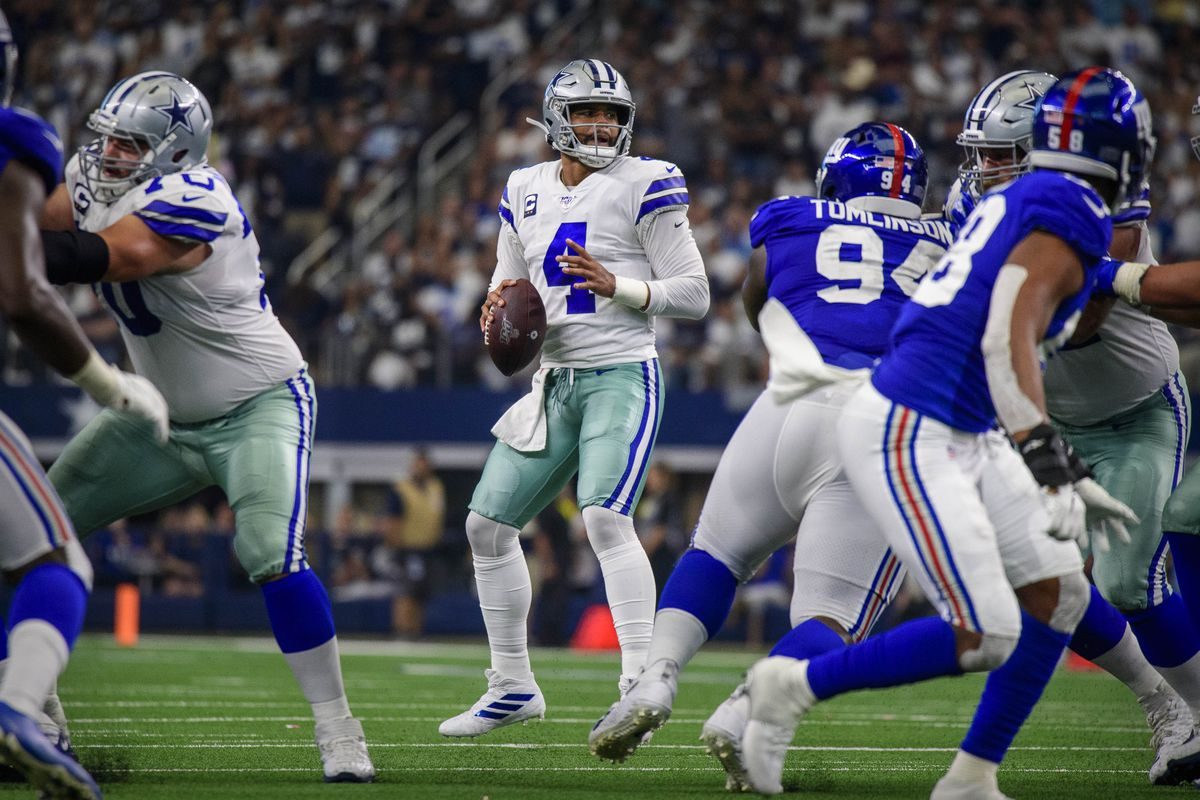 Dallas Cowboys quarterback Dak Prescott drops back to pass against the New York Giants during the second half at AT&T Stadium.