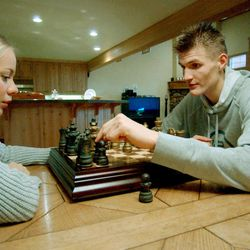 Former Utah Jazz player Andrei Kirilenko and wife, Masha Kirilenko, enjoy a game of chess in their Salt Lake home on Nov. 21, 2001. The couple now lives in New York City, but they maintain their home in Salt Lake City and frequently visit. Their Utah home was burglarized over the weekend.