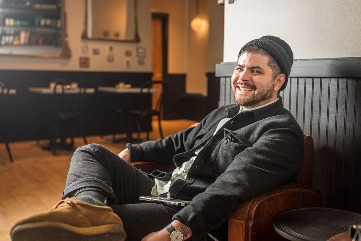 A portrait of ABC Pony chef Erik Bruner-Yang sitting and smiling