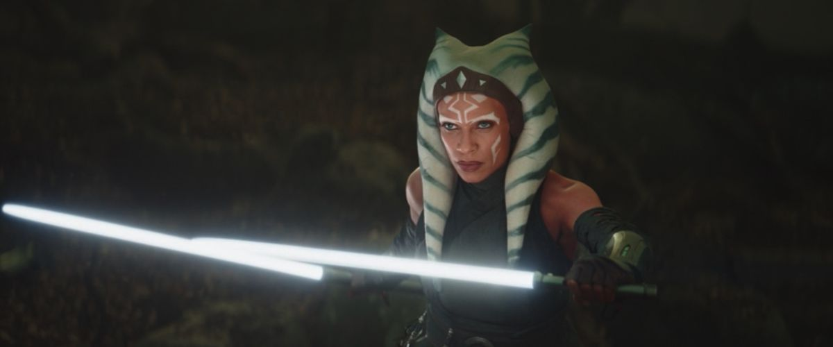 Rosario Dawson as Ahsoka Tano in The Mandalorian holding two white lightsabers